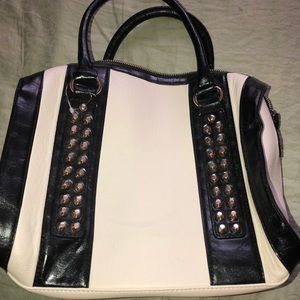 Cream and black shoulder bag with studs